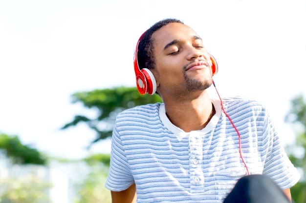 relaxed-young-man-loving-music-enjoying-nature_1262-3611.jpg